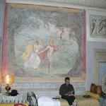 Frescos on walls. Quad room