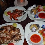 Delicious Fish and Prawns BBQ served with veggies and potatoes/rice