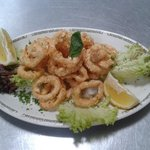 """Calamari Fritti""  (fried calamari in a seasoned light batter)"