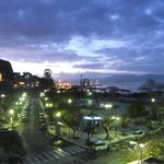 View from balcony over port as evening falls