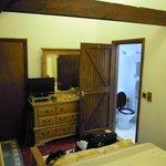 Room, TV area and door to bathroom.