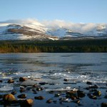 loch overlooking cairngorm mountains