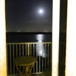 Moonlight out patio door over balcony.