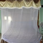 The bed with mosquito netting
