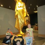 By the angel Moroni which tops LDS temples