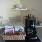 Coffee maker and extras to make a meal in the room easier.