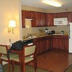Living room in 1 bedroom 2 doubles suite, kitchen area
