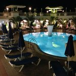 A Night time view of the bottom pool and Nostelgia Restaurant