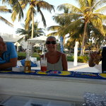 mr.& mrs. ashworth with john enjoying thier drinks