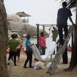 charm churee staff setting beach up for a wedding