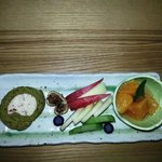 dessert of roll cake with artfully sculpted apples and citrus