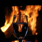 Cheery fire with a glass of wine