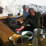 barbecue in the snow on a sunny day