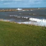 View of waves crashing over the pier at North Shields