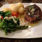 Beef steak with potatoes and vegetables - (sauce beside)