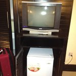 The refrigerator is located under the TV. There are many viewing options in di