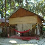 The cabanas with personal hammocks and rocking chairs