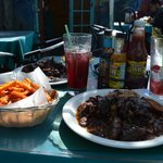 Oxtail with rice and peas, sweet potato fries and sangria