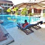 Pool facing the hotel lobby; pool villas