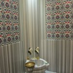 Marble and Iznik tile lined hammam in room