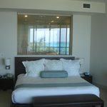 That's the shower behind the bed and it has view of ocean, too!
