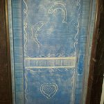 Each room door is hand-painted wood, with