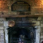 Wisdom above the bar fireplace