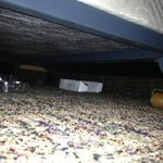 Trash left under a bed found when looking for a shoe, from prior tenant of roo