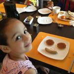 My daughter Joud with a nice smile with breakfast