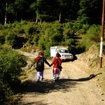 the road to dharmakot, village children walking to school