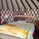 king size bed in the yurt.