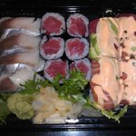 Take out sushi as presented upon opening.