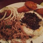 slow roasted pork with rice, beans and plantains