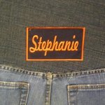 Name (mine) stitched on back of booth seats.