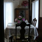 Dining room suite set beside large windows