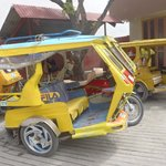 $150.00 peso for our ride to puka in this tricycle