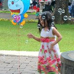 a girl playing with the bubble