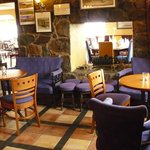 Enjoy a drink in our cosy bar before dining