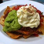 Nachos with avocado, sour cream, salsa & corn chips