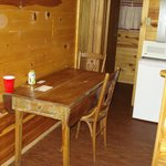Kitchen table Cabin #6 and bathroom door behind that.