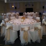 Table for 10 guests with beautiful bespoke chair covers.