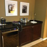 large bar area with huge refrigerator and wet bar area and a