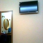 tv in front of bed