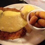 Chicken fried steak with yellow gravy, mashed potatoes & corn fritters
