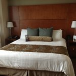 Bed in Room 1518 w/ side char & night stands.  Window w/ view of San Diego is to the left.