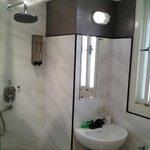 bath complete with rain shower, toilet, basin