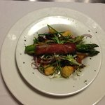 Asparagus wrapped in parma ham with halloumi cheese red onion & tomato salad