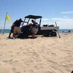 4x4 broken down on beach in front of us