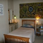 Our very comfortable ensuite single with a genuine African tapestry