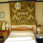Our comfortable double bedroom with its ethnic tapestry